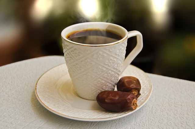 a cup of turkish coffee with dates